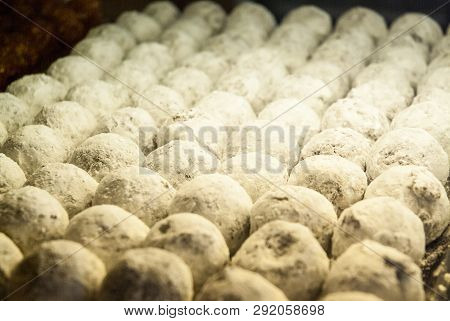 Close Up Of Sweet White Balls With Powdered Sugar Displayed In Patisserie