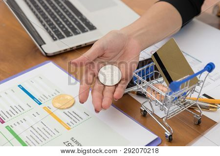 Business And Finance Concept, Businesswoman Holding Bitcoin For E-commerce Online Shopping.