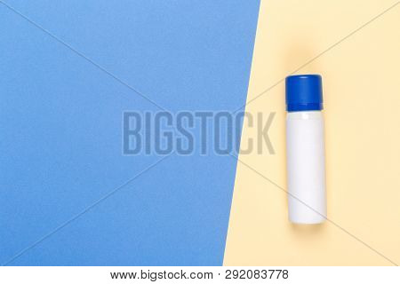 Cosmetic product on a bright bicolor background, top view poster