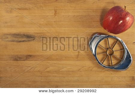 Apple And Corer On A Wooden Countertop