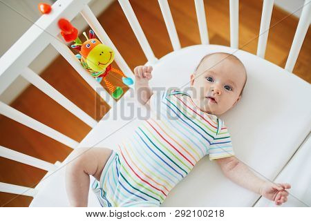 Baby Girl In Co-sleeper Crib