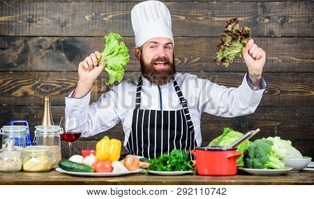 Eat Healthy. Dieting Concept. Man Wear Hat And Apron Hold Lettuce. Healthy Nutrition. Bearded Hipste