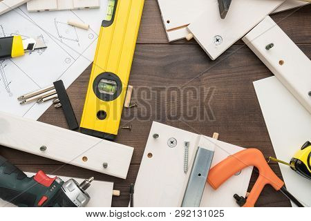 Furniture Parts And Tools During Assembly Process. Furniture Assembly Concept. Furniture Assembly On