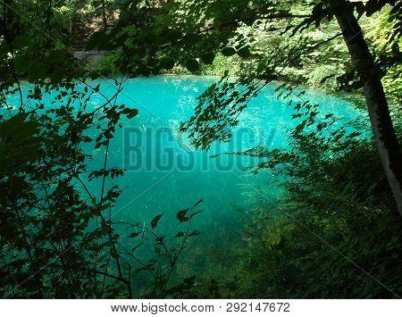 Turquoise Water Of Blautopf, Karstic Spring Of River Blau In Swabian Alb, Germany