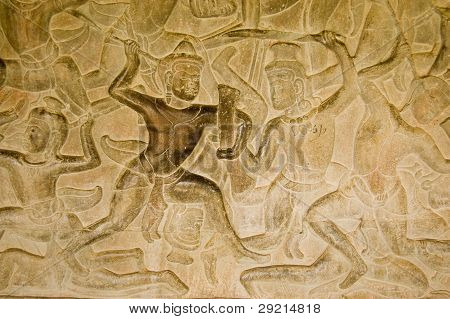 Ancient Khmer bas relief carving of gods fighting demons, devas versus asuras.  Inner wall of the temple of Angkor Wat, Siem Reap, Cambodia. poster
