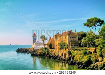 Lighthouse Santa Maria And Museum Of This Lighthouse Located In The Cascais, Portugal , During Sunse