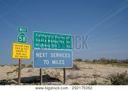 Taft, California - March 25, 2019: Road Signs Warn Drivers Of Desolate Conditions - Next Services 70