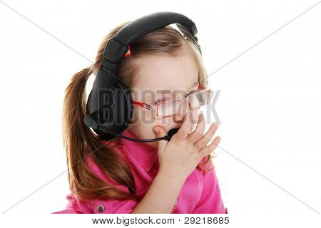 Small child girl wearing a head to headset
