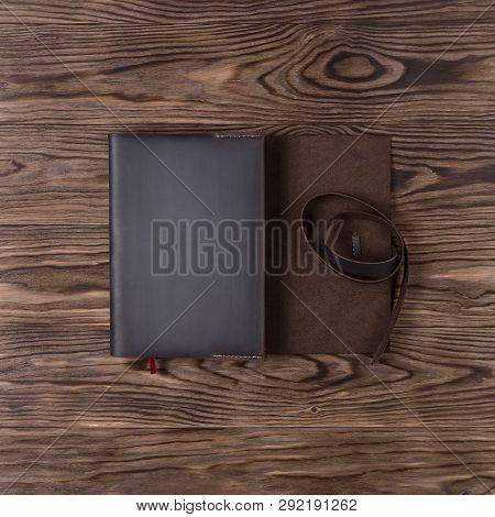 Brown Handmade Leather Notebook Cover With Notebook On Wooden Background. Stock Photo Of Luxury Busi