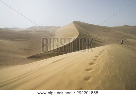 Gobi Desert, China - 08 07 2016 : Hike In The Gobi Desert. Sand Dunes With Footprint In The Gobi Des