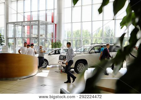 Kazan, Russia - August 31, 2018: Manager And Buyers In Car Showroom Of Dealership Toyota In Kazan