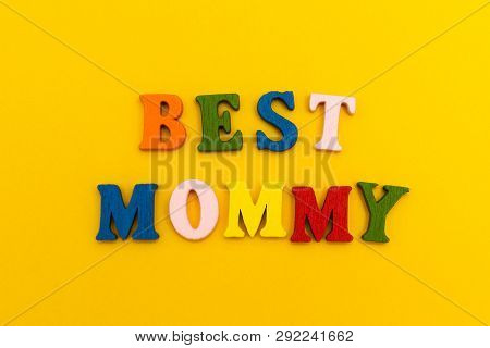 "The inscription ""Best Mommy"" in colorful letters on a yellow background. poster"