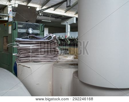 Newsprint Roll In The Production Shop Of Printing House. Set Of Layers Of White Paper. Production Sh