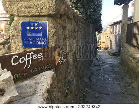 HUM, CROATIA - 28 MARCH 2019: typical street sign in Hum, the smallest village in the world.