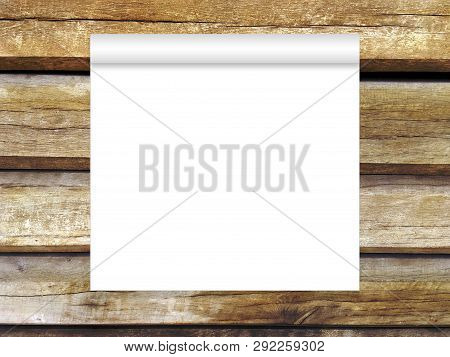 Blank White Paper Scroll On Wooden Wall Background