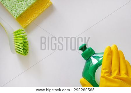 Cleaning Service Concept. Cleaning Set With Green Tools On Light Background. Top View Cleaning Acces