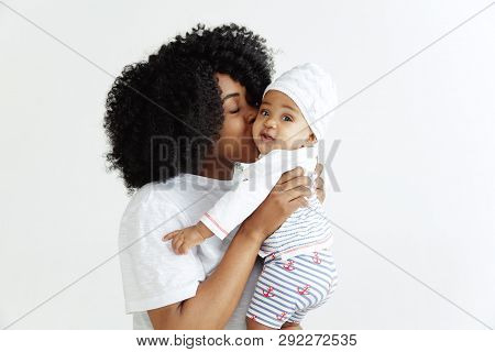 Closeup Portrait Of Beautiful African Woman Holding On Hands Her Little Daughter On White Background