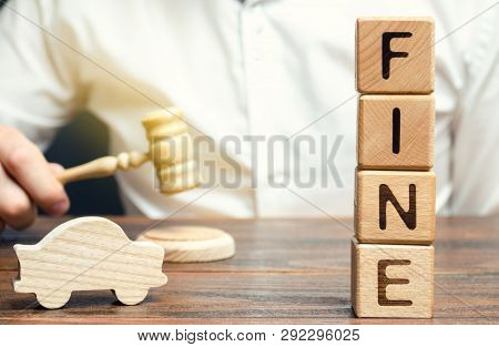 Wooden blocks with the word Fine, wooden car and judge. Violation of traffic laws. Penalty as a punishment for a crime and offense. Financial punishment. Fraud. Fines can also be used as a form of tax poster