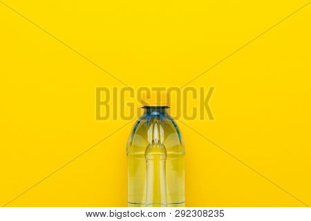 Plastic Water Bottle With Yellow Cap. Water Bottle On The Yellow Background. Photo Of Plastic Bottle