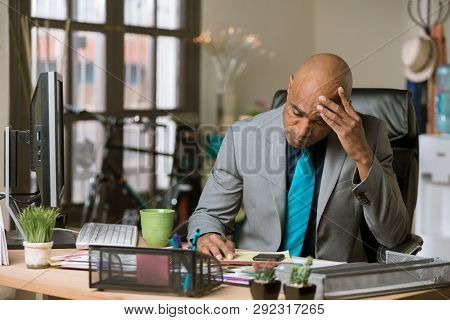 Overworked Professional Man In His Office With A Window