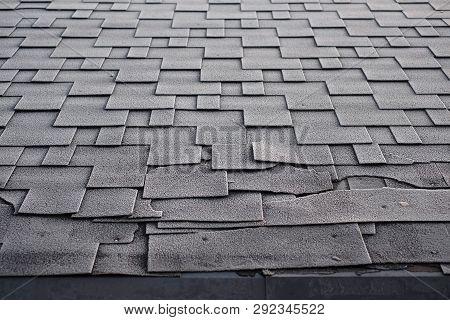 Shingles Roof Damage Covered With Frost. Close Up View On Asphalt Roofing Shingles Background. Roof