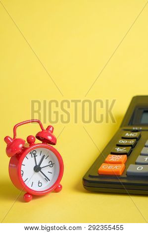 Concept Time Counting Revenues And Expenditures Of The Budget. A Red Vintage Clock Is Next To A Calc