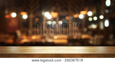 Empty Wooden Table Top With Blur Coffee Shop Or Restaurant Interior Background, Panoramic Banner. Ab