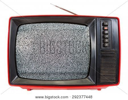 Red vintage portable CRT TV set made in USSR with television static noise on screen isolated on white background. Retro technology concept