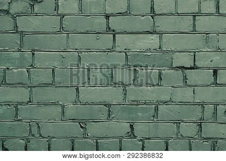 Abstract Closeup Of Texture Green Brick Wall. Light Green Textured Grunge Background. Chlorine Concr