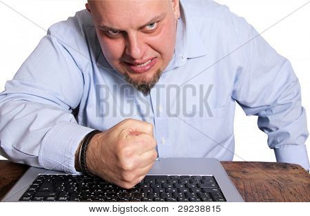 Angry man in front of computer