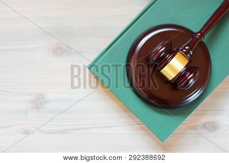 Judges Gavel Or Law Mallet On Green Law Book On Wooden Texture Table. Legal Law, Justice System, Edu