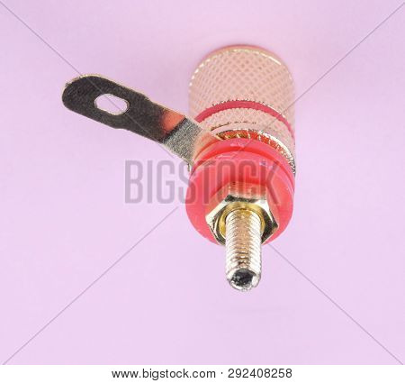 Image Of One Speaker Connector On Pink Background