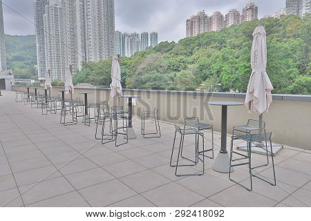 Metal Chair Outside On A Roof Garden Hk