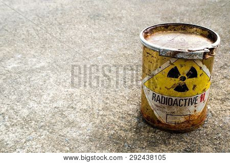 Rusty Package Of Radioactive Material Container On The Rough Concrete Floor