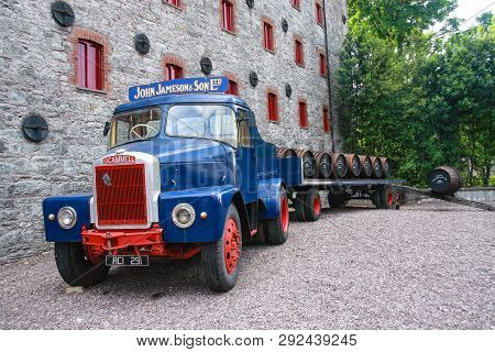 Cork, Ireland - June 20, 2008:  Loading Wooden Barrels On Old Open Truck Trailer In Museum Of Irish