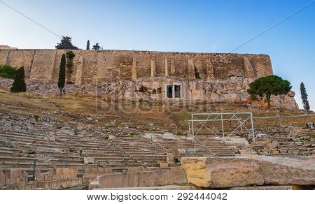 View Of Acropolis Walls And Hill Slopes And Theater Of Dionysus In Athens, Greece At Sunset