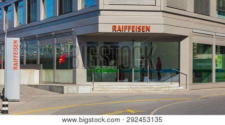 Chur, Switzerland - September 27, 2018: An Office Of The Raiffeisen Bank In The City Of Chur, People