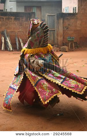 An Egun dancer of the Bobo tribe performing a ceremony in Benin, Africa