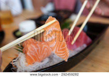 Japanese Sushi Food,close Up Of Sashimi Sushi With Chopsticks.
