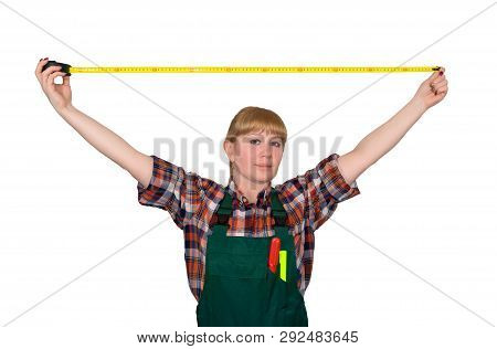 young woman in work overalls holding a tensioned tape measure isolated on white background poster