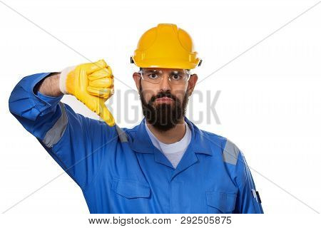 Portrait Architect Builder In Transparent Safety Glasses. Bearded Man Worker In Hard Hat With Angry