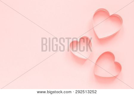 Pink Cutters Cookies In Heart Shape On Pastel Pink Background, Colar Toned. Love Romantic Pattern, T
