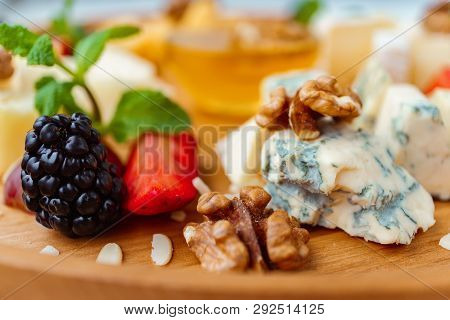 Blue Cheese, Dorblu Slices Close Up. Cheeseboard Served With Fruits, Walnuts And Honey. Delicious Sn