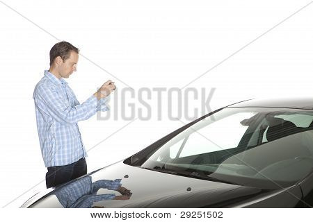 Man Taking Picture Of Car