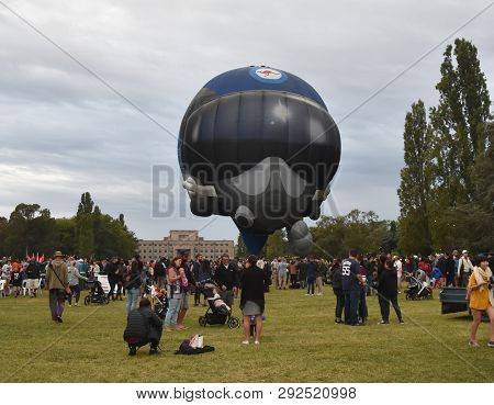 Canberra, Australia - March 9, 2019. Big Helmet Hot Air Balloon Launching From The Grounds Of Old Pa