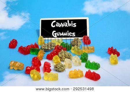 Marijuana Gummy Bears. Marijuana or Cannabis infused gummy candies. THC infused Gummies. CBD Infused Jellies. Sign is editable with your text.  Blue Sky background.