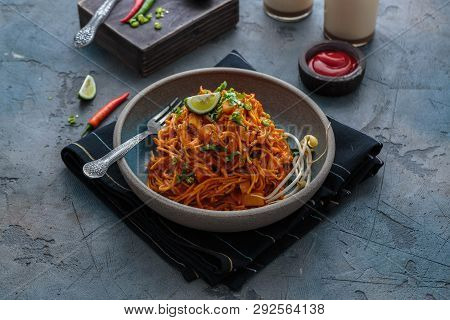 Mee Goreng Mamak, Indonesian And Malaysian Cuisine, Spicy Fried Noodles In A Plate, Copy Space