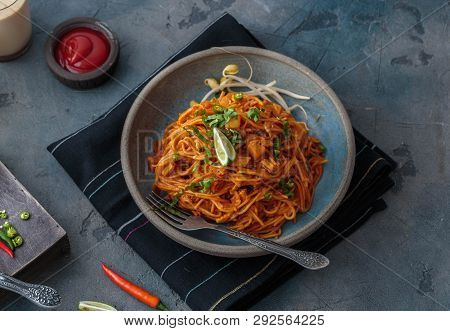 Spicy Mee Goreng Mamak, Malaysian Or Singaporean Fried Noodles With Ketchup And Chili