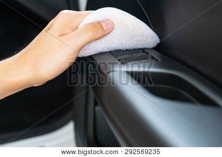 Closeup for man polishing cleaning car with microfiber cloth poster