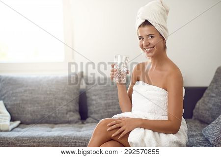 Happy Attractive Young Woman With A Cute Friendly Grin Wearing A Clean White Towel Around Her Hair H